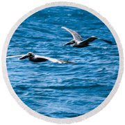 Two Pelicans Flying Round Beach Towel