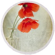 Two Poppies In A Glass Vase Round Beach Towel
