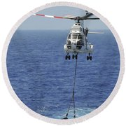 Two Sa-330 Puma Helicopters Deliver Round Beach Towel by Stocktrek Images
