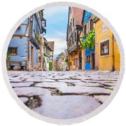 half-timbered houses, Riquewihr, Alsace, France   Round Beach Towel