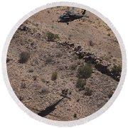 Uh-60 Black Hawk Hovers Above U.s Round Beach Towel