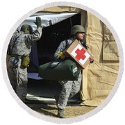 U.s. Air Force Soldier Exits A Medical Round Beach Towel