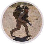 U.s. Marine Runs To The Uh-60 Black Round Beach Towel