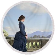 Victorian Woman In A Blue Dress Standing On The Terrace  Round Beach Towel