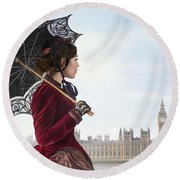 victorian woman with parasol in 19th century London  Round Beach Towel