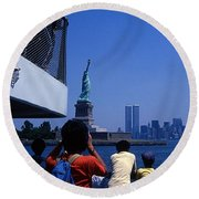 View Of Statue And Towers Round Beach Towel
