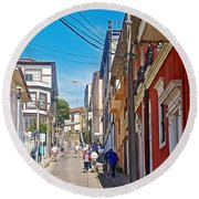Walking Up Steep Streets In Hilly Valparaiso-chile Round Beach Towel
