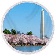 Washington Monument And Cherry Blossoms Round Beach Towel