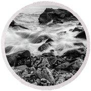 Waves Against A Rocky Shore In Bw Round Beach Towel by Doug Camara