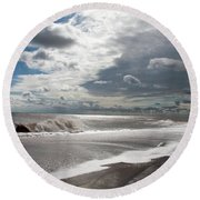 Waves Breaking Against The Beach And Cloud Streaming Above  Skegness Lincolnshire England Round Beach Towel