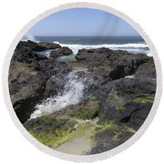 Waves Crash Ashore On A Lava Bed Round Beach Towel