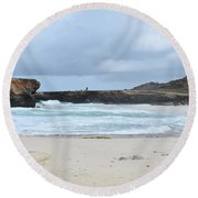 Waves Crashing Ashore With Large Rock Formations Round Beach Towel