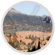 West Springs And Distant Garden Of The Gods Round Beach Towel