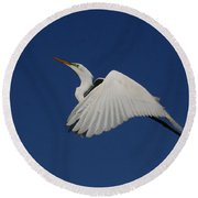 White Egret Soaring Into The Blue Round Beach Towel