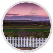 White Picket Fence Looking Over Farmland  Round Beach Towel