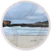 White Sand Beach And Large Rock Formations In Aruba Round Beach Towel