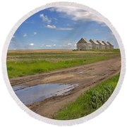 White Sheds On A Prairie Farm In Spring Round Beach Towel