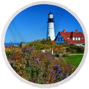 Wild Flowers Fading At The Portland Head Light Round Beach Towel