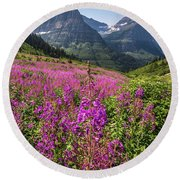 Wildflowers And A Glacier Round Beach Towel