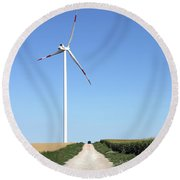 Wind Turbine On Field With Country Road Round Beach Towel