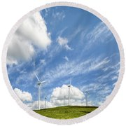 Wind Turbines On A Hill Under A Blue Sky Round Beach Towel