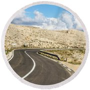 Winding Road On The Pag Island In Croatia Round Beach Towel