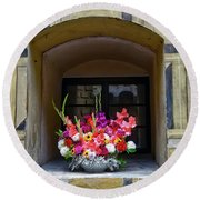 Window Sill Flower Arrangement At Cesky Krumlov Castle In The Czech Republic Round Beach Towel