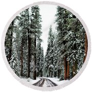 Wintry Forest Drive Round Beach Towel