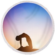 Woman In Camel Yoga Pose Meditating At Sunset Round Beach Towel