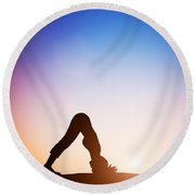 Woman In Dolphin Yoga Pose Meditating At Sunset Round Beach Towel