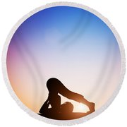 Woman In Plow Yoga Pose Meditating At Sunset Round Beach Towel
