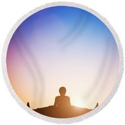 Woman In Wide Angle Bend Yoga Pose Meditating At Sunset Round Beach Towel