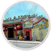 Woman Sits Outside Chinese Temple With Urn And Deity Statues Pattani Thailand Round Beach Towel