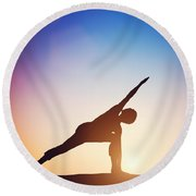 Woman Standing In Revolved Side Angle Yoga Pose Meditating At Sunset Round Beach Towel