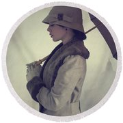 Woman With Vintage Cloche Hat Overcoat And Umbrella In Rain Round Beach Towel