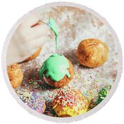 Woman's Hand Coating A Donut With Green Frosting. Round Beach Towel