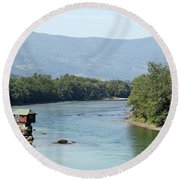 wooden house on rock Drina river Serbia Round Beach Towel