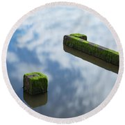 Wooden Posts At Low Tide Round Beach Towel