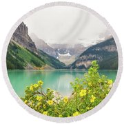 Yellow Flowers At Lake Louise Round Beach Towel