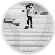 Young Child Jumping Down Steps Round Beach Towel