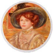 Young Woman In A Blue Hat Round Beach Towel by Pierre Auguste Renoir