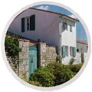 french houses in the streets of Saint Martin de re Round Beach Towel