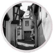 old historic street in Ediger Germany Round Beach Towel