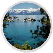 Rocks In A Lake With Mountain Range Round Beach Towel