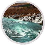 The Beautiful Cascades Of Hraunfossar In Iceland. Round Beach Towel