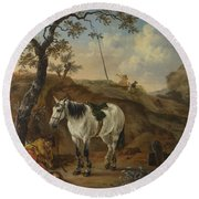 A White Horse Standing By A Sleeping Man  Round Beach Towel