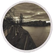 Walking Along The Seine At Sunset Round Beach Towel