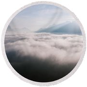 Aerial View Of Low Clouds And Mountain Peak At Sunrise Round Beach Towel