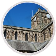 architecture of Hexham cathedral and clock tower Round Beach Towel