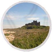 Bamburgh Castle And Beach In Summer Round Beach Towel